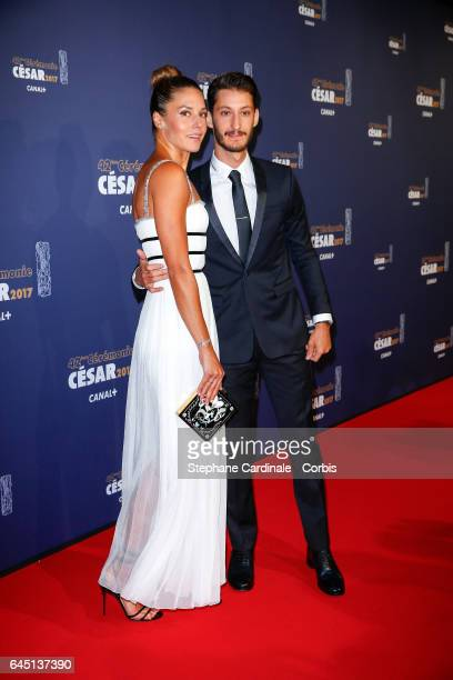 Natasha Andrews and Pierre Niney arrive at the Cesar Film Awards 2017 ceremony at Salle Pleyel on February 24 2017 in Paris France