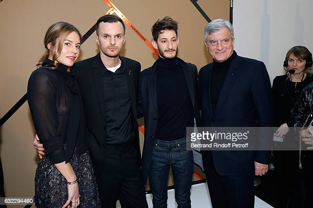 Natasha Andrews Stylist Kris Van Assche Pierre Niney and CEO Dior Sidney Toledano pose backstage after the Dior Homme Menswear Fall/Winter 20172018...