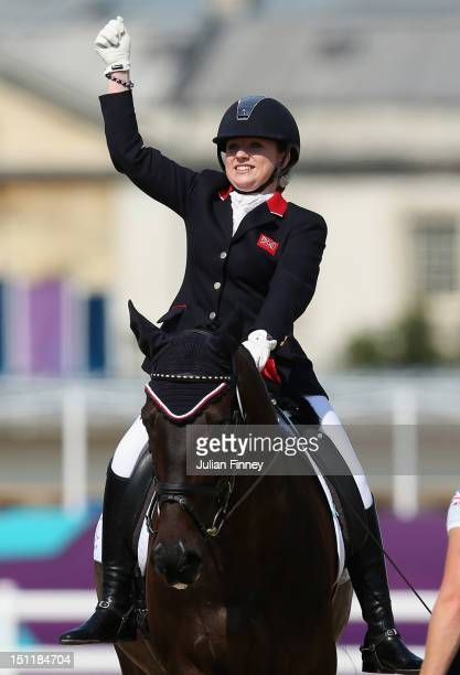 Natasha Baker of Great Britain celebrates on her way to winning gold in the Dressage Individual Freestyle Test Grade II in the Equestrain on day 5 of...