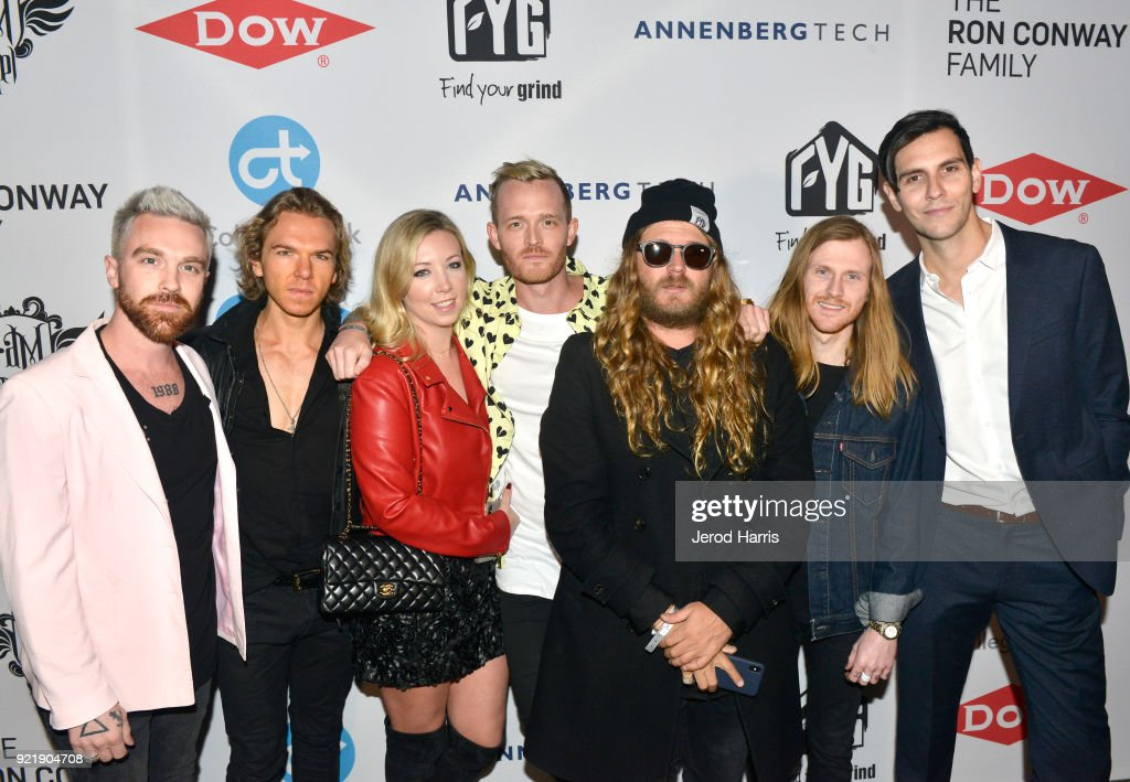 Natasha Barritt and Nick Gross with the Find Your Grind Foundation team at will.i.am's i.am.angel Foundation TRANS4M 2018 Gala, Honoring Sean Parker, Chairman, Parker Institute for Cancer Immunotherapy at Milk Studios on February 20, 2018 in Hollywood, California.