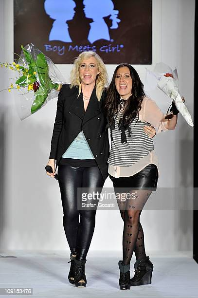 Natasha Bedingfield and Stacey Igel acknowledge the crowd on the runway at the Boy Meets Girl Fall 2011 fashion show at Metropolitan Pavilion on...