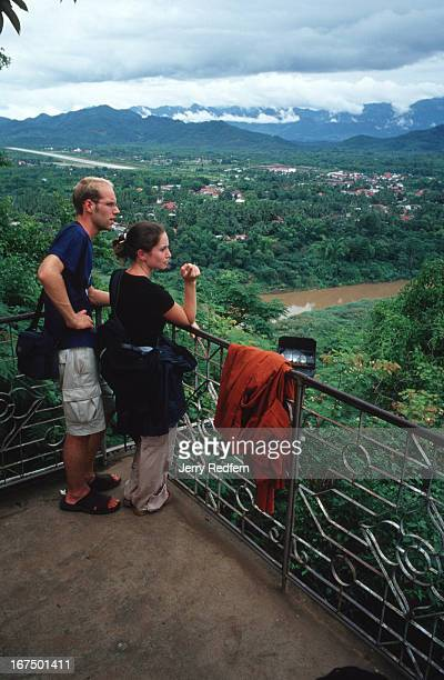 Natasha Belenkin and Richard Robinson of the UK take in the view from the top of Mount Phousi in the middle of Luang Prabang The two were on an...
