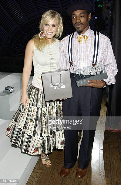 Natasha Billingfield and Andre 3000 poses in the pressroom with the award for at the GQ Men Of The Year Awards at the Royal Opera House on September...