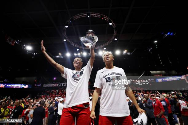 Natasha Cloud and Aerial Powers of Washington Mystics celebrate after defeating the Connecticut Sun to win the 2019 WNBA Finals at St Elizabeths East...