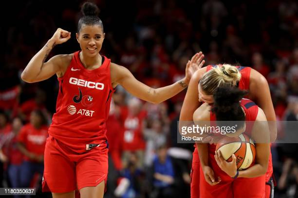 Natasha Cloud, , Elena Delle Donne and Kristi Toliver of Washington Mystics celebrate during the closing seconds of their win over the Connecticut...