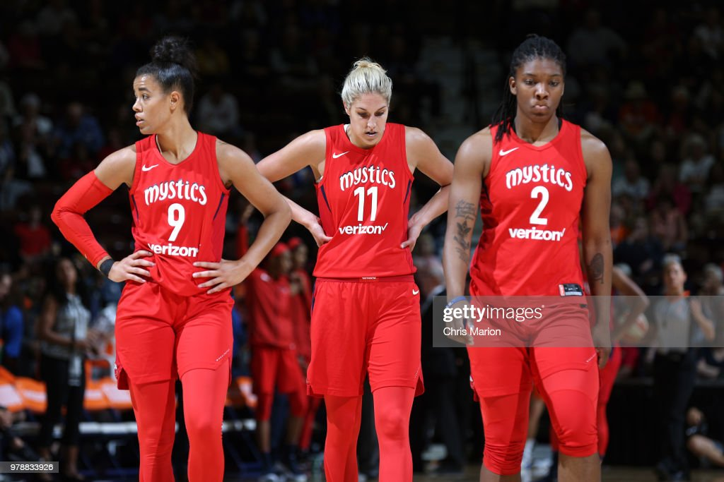 Natasha Cloud #9, Elena Delle Donne #11, and Myisha Hines-Allen #2 of the Washington Mystics look on during a WNBA game on June 13, 2018 at the Mohegan Sun Arena in Uncasville, Connecticut.