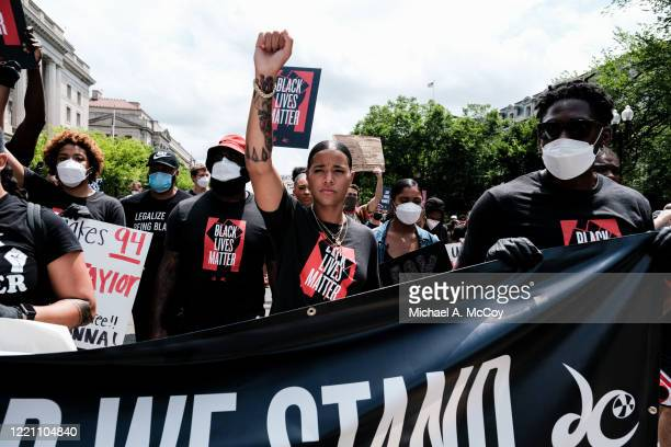 Natasha Cloud marches to the MLK Memorial to support Black Lives Matter and to mark the liberation of slavery on June 19, 2020 in Washington, DC....