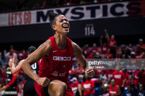 Natasha Cloud of the Washington Mystics celebrates against the Las Vegas Aces during the second half of Game One of the 2019 WNBA playoffs at St...