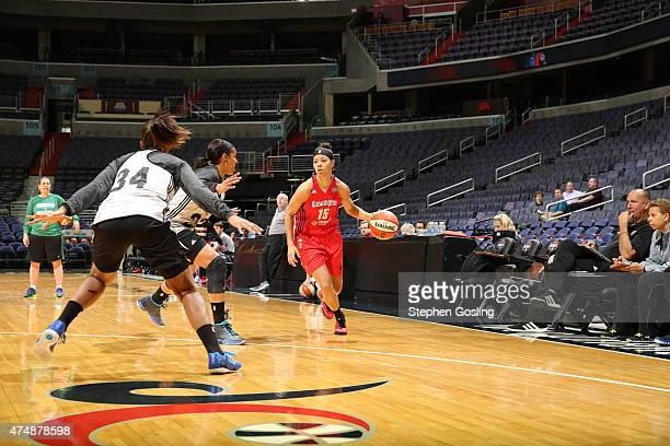 Natasha Cloud of the Washington Mystics drives against the Minnesota Lynx during an Analytic Scrimmage at the Verizon Center on May 26 2015 in...