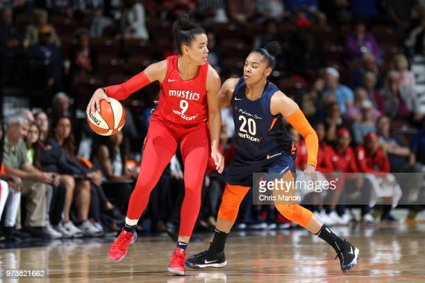 Natasha Cloud of the Washington Mystics handles the ball against Alex Bentley of the Connecticut Sun during a WNBA game on June 13 2018 at the...