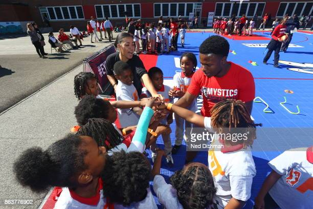 Natasha Cloud of the Washington Mystics participates in a clinic at Hendley Elementary school during a court dedication and WNBA Fit Clinic on...