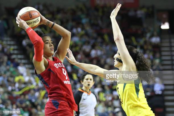 Natasha Cloud of the Washington Mystics works against Sue Bird of the Seattle Storm in the third quarter during game one of the WNBA Finals at...
