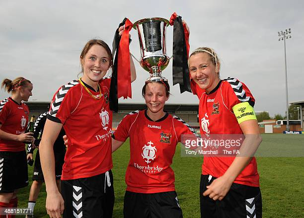 Natasha Cooke, Lisa Giampala and Carla Ward of Sheffield FC Ladies celebrate with the trophy during the FA Women's Premier League Cup Final between...