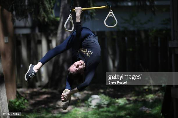 Natasha Danchenko, an aerialist specializing in silks maintains her strength by training on the backyard swing set of her home as the Toronto arts...