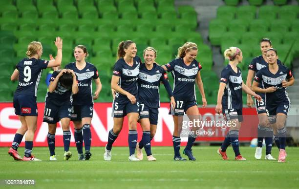 Natasha Dowie Melina Ayres Dani Weatherholt Christine Nairn Emily Gielnik of the Victory and their teammates celebrate after Elise KellondKnight of...