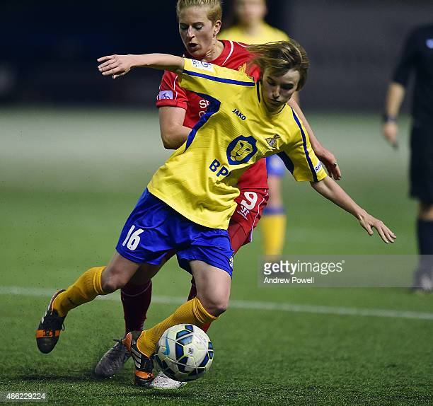 Natasha Dowie of Liverpool competes with Ashleigh Mills of Doncaster Rovers Ladies during a Pre Season friendly match between Liverpool Ladies and...