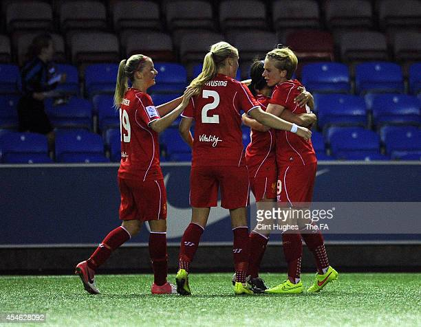 Natasha Dowie of Liverpool Ladies FC celebrates with her team-mates after she scores the first goal of the game for her side during the FA WSL 1...