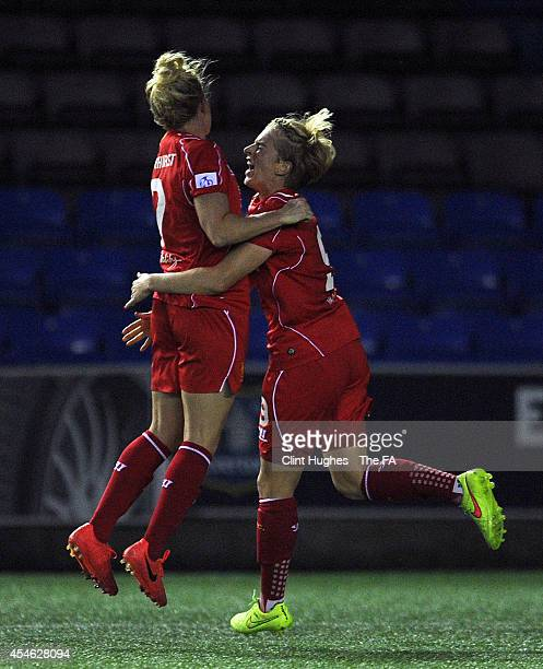 Natasha Dowie of Liverpool Ladies FC celebrates with team-mate Kate Longhurst after she scores the first goal of the game for her side during the FA...
