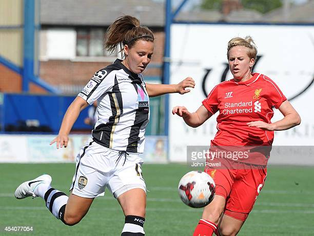 Natasha Dowie of Liverpool moves in on Rachel Corsie of Notts County at Select Security Stadium on August 24, 2014 in Widnes, England.