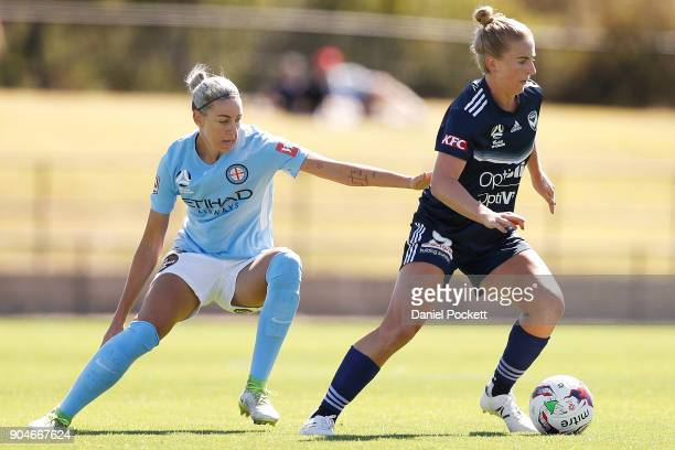 Natasha Dowie of Melbourne Victory and Alanna Kennedy of Melbourne City contest the ball during the round 11 WLeague match between the Melbourne...