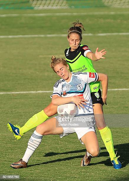 Natasha Dowie of Melbourne Victory and Ellie Brush of Canberra United contest possession during the round 10 W-League match between Canberra United...