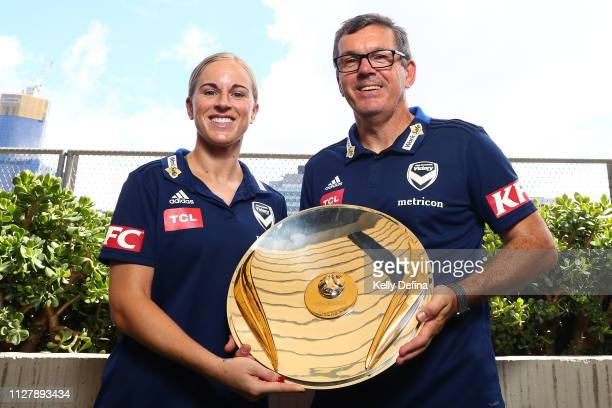 Natasha Dowie of Melbourne Victory and Jeff Hopkins head coach of Melbourne Victory hold the Westfield W-League premiership plate during a Melbourne...