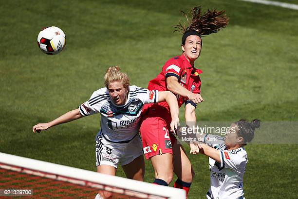 Natasha Dowie of Melbourne Victory and Kathleen Naughton of Adelaide United competes during the round one WLeague match between Adelaide United and...