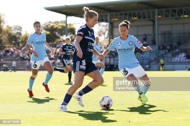 Natasha Dowie of Melbourne Victory and Lauren Barnes of Melbourne City contest the ball during the round 11 WLeague match between the Melbourne...