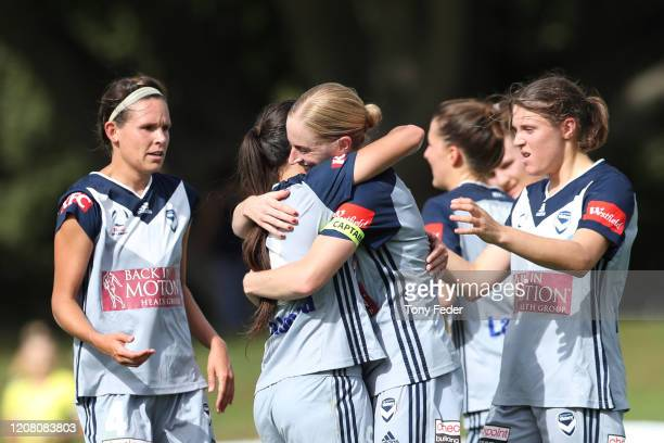 Natasha Dowie of Melbourne Victory celebrates a goal with team mates during the round 13 W-League match between the Newcastle Jets and the Melbourne...