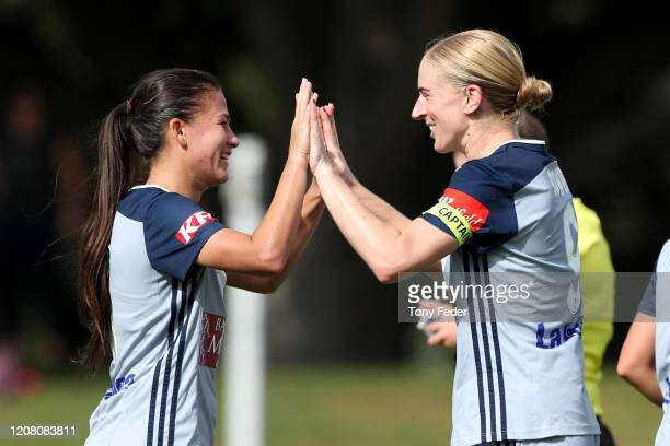 Natasha Dowie of Melbourne Victory celebrates a goal with team mates during the round 13 WLeague match between the Newcastle Jets and the Melbourne...
