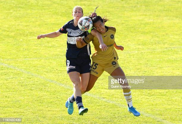 Natasha Dowie of the Victory and Alexandra Huynh of the Wanderers compete for the ball during the round four W-League match between the Melbourne...