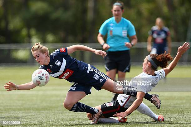 Natasha Dowie of the Victory and Carmelina Moscato of the Wanderers compete for the ball during the round nine W-League match between the Melbourne...