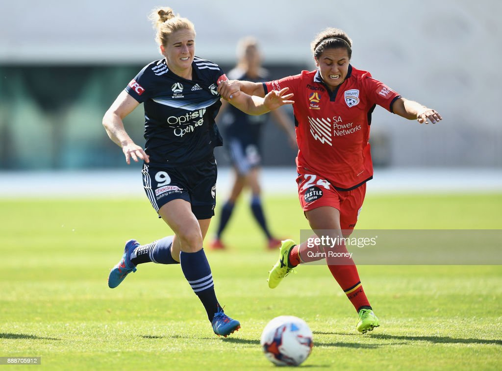 Natasha Dowie of the Victory and Danielle Colaprico of Adelaide United compete for the ball during the round seven W-League match between the Melbourne Victory and Adelaide United at Lakeside Stadium on December 9, 2017 in Melbourne, Australia.