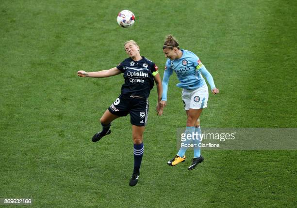 Natasha Dowie of the Victory and Steph Catley of Melbourne City compete for the ball during the round two W-League match between Melbourne City FC...
