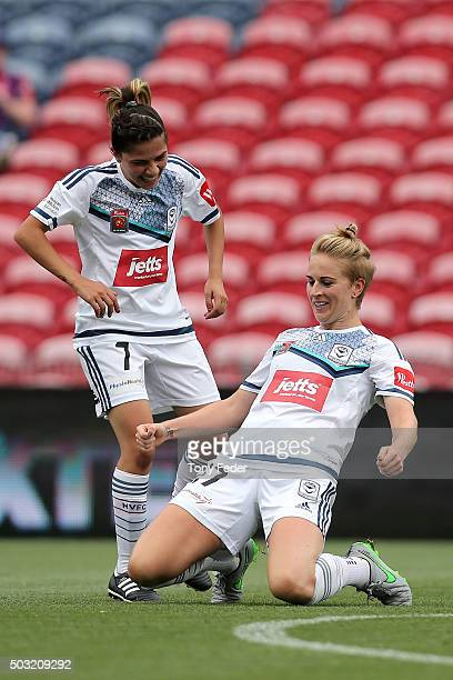 Natasha Dowie of the Victory celebrates a goal with team mate Enza Barilla during the round 12 W-League match between the Newcastle Jets and the...