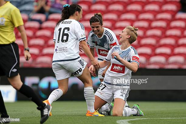 Natasha Dowie of the Victory celebrates a goal with team mates during the round 12 W-League match between the Newcastle Jets and the Melbourne...