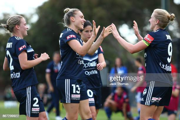 Natasha Dowie of the Victory celebrates a goal with team mates during the round one WLeague match between Melbourne Victory and Canberra United at...