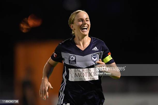 Natasha Dowie of the Victory celebrates after Kaitlyn Torpey of the Roar scored an own goal during the round two W-League match the between Brisbane...