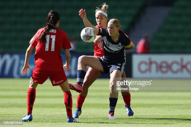 Natasha Dowie of the Victory competes for the ball against against Amber Brooks of United during the round one WLeague match between Melbourne...