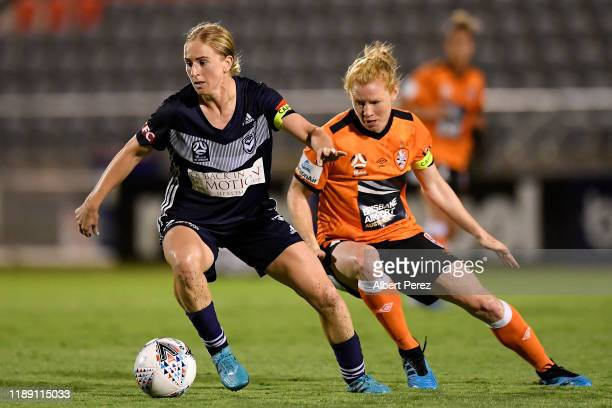 Natasha Dowie of the Victory controls the ball in front of Clare Polkinghorne of the Roar during the round two W-League match the between Brisbane...