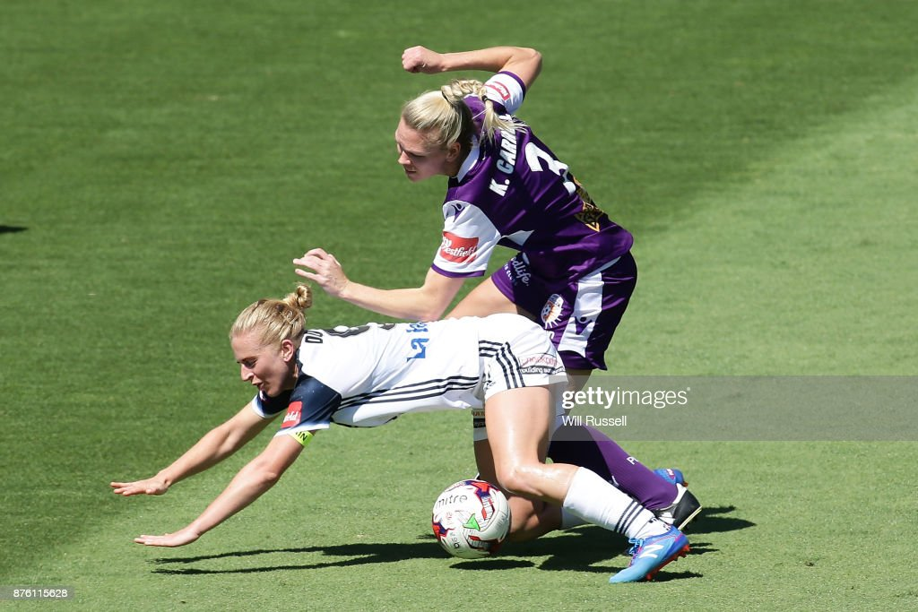 Natasha Dowie of the Victory falls after a challenge from Kim Carroll of the Glory during the round four W-League match between Perth Glory and Melbourne Victory at nib Stadium on November 19, 2017 in Perth, Australia.