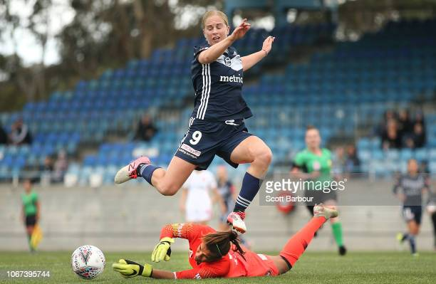 Natasha Dowie of the Victory jumps over goalkeeper Jada Mathyssen-Whyman of the Wanderers as she makes a save during the round five W-League match...