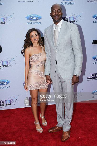 Natasha Duffy and John Salley arrives at the 2013 BET Awards Make A Wish Arrivals at Nokia Plaza LA LIVE on June 30 2013 in Los Angeles California