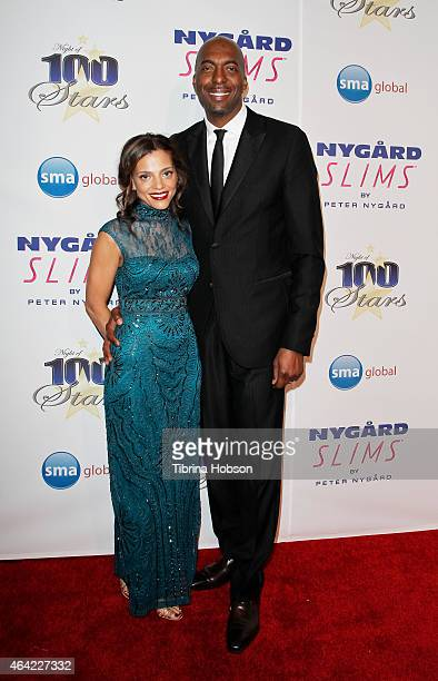 Natasha Duffy and John Salley attend the Norby Walters 25th annual night of 100 stars Oscar viewing gala at The Beverly Hilton Hotel on February 22...