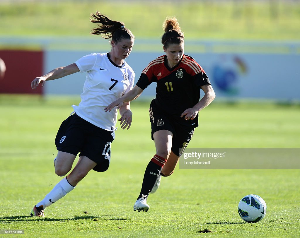Natasha Flint of England tackles Lina Burger of Germany during the Women's International Friendly match between England Under 19 Women and Germany Under 19 Women at St George's Park on September 22, 2013 in Burton upon Trent, England.