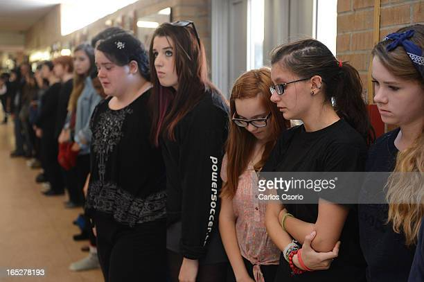 Natasha Foster and Ines Valente obseve a minute of silence at Etobicoke School of the Arts Students from a grade 10 drama class observered their...