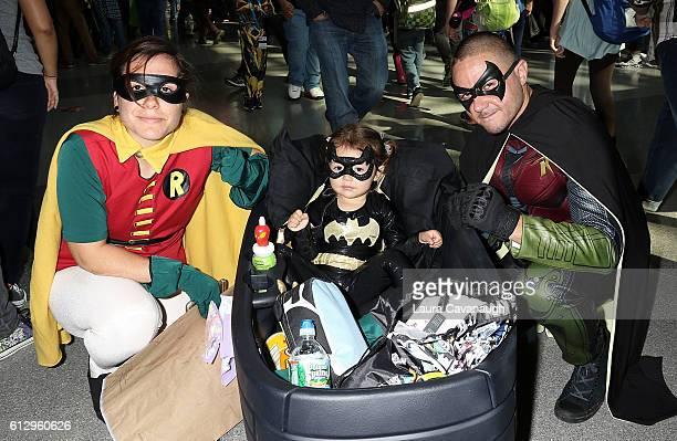 Natasha Gallo Mia Gallo and Genaro Gallo dressed asRobin Batgirl and Batman attend New York Comic Con Day 1 on October 6 2016 in New York City