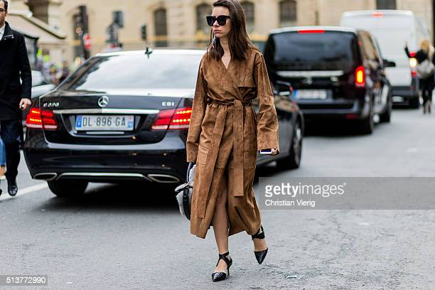 Natasha Goldenberg is wearing a brown long coat and black heels outside Dior during the Paris Fashion Week Womenswear Fall/Winter 2016/2017 on March...