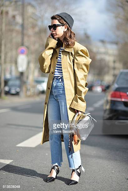Natasha Goldenberg poses wearing Vetements pants and Loewe bag after the Paco Rabanne show at the Musee d'art Moderne during Paris Fashion Week FW...