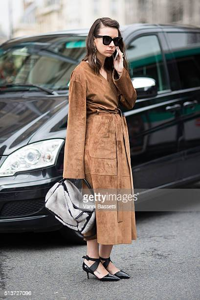 Natasha Goldenberg poses with a Loewe bag after the Dior show at the Louvre during Paris Fashion Week FW 16/17 on March 4 2016 in Paris France